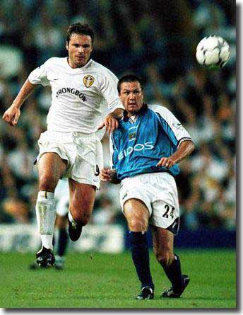 6b628a2ce96 Part 2 Aussie striker Mark Viduka in early season action at Elland Road  against Steve Howey of Manchester