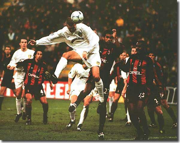 Dominic Matteo heads home a goal against AC Milan during the memorable Champions League run of 2000-01