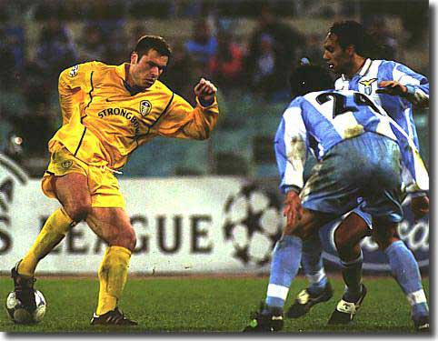 The talented Australian, Mark Viduka, drags the ball back to engineer the goal for Alan Smith