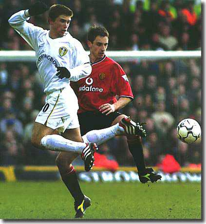 Harry Kewell shows off his party pieces against Manchester United's Gary Neville