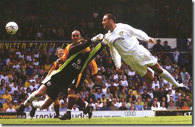 Mark Viduka sails through the air to score in the slaughter of Bradford City