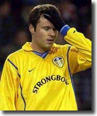 Mark Viduka has that sinking feeling as Leeds miss another chance in the away match at PSV Eindhoven