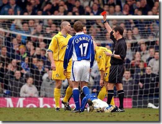 Dominic Matteo is given his marching orders by Andy D'Urso after two reckless tackles at Goodison Park