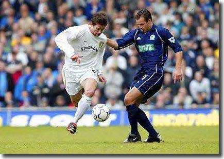 Harry Kewell takes on Blackburn's Lucas Neill at Elland Road