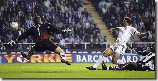 Mark Viduka scores the opening goal at Newcastle, beating keeper Shay Given