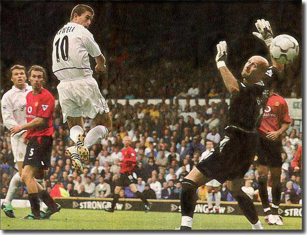 Harry Kewell rises to nod past Manchester United keeper Fabien Barthez with Mark Viduka and Laurent Blanc looking on