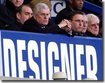 Peter Ridsdale is grim faced during a 2-0 defeat at Everton in February 2003 as Leeds battle relegation - Professor John McKenzie on the far right was soon to succeed Ridsdale as chairman