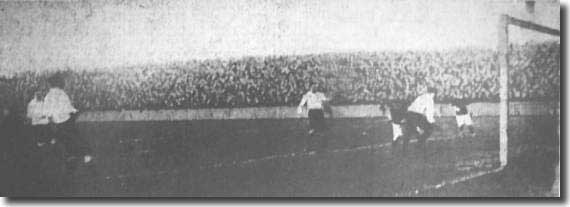 Fred Parnell follows up his own ball, dodges the Clapton Orient left-back and scores in a 3-2 victory at Elland Road on December 1 1906