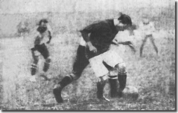 Cubberley shields the ball from a Grimsby player in December 1907