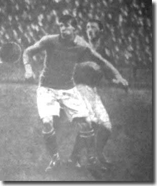 Billy Halligan charges a Birmingham defender from behind in the game on 12 February 1910 - it was the Irishman's final game for Leeds before a big money move to Derby