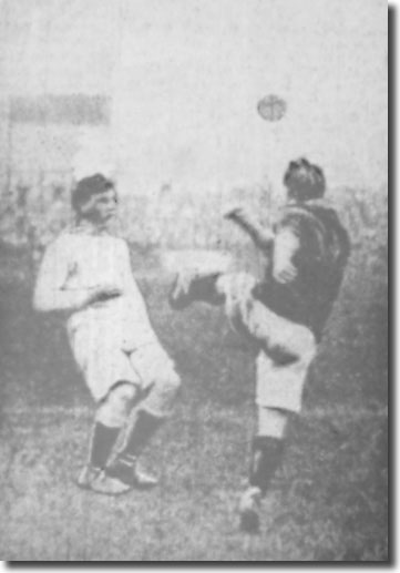 Alec Creighton clears from a Huddersfield forward in the Elland Road derby 7 October 1911