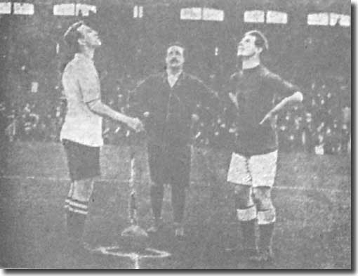 New City skipper Evelyn Lintott and referee Pellowe watch as Fulham captain Mavin tosses at the start of the opening match of the season at Craven Cottage on 7 September 1912