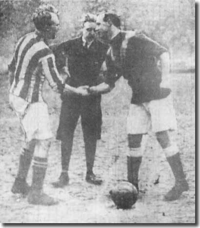 Jimmy Speirs shakes hands with West Bromwich Albion captain Jesse Pennington before the FA Cup-tie on 31 January