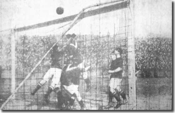 Woolwich Arsenal keeper Lievesley defends his goal during a City attack on 11 April