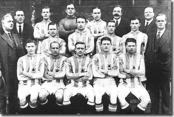 The Huddersfield Town squad 1919-20.  Captain Fred Bullock is third right in the back row, directors N Robinson and F C Mitchell are next to him.  Chairman W L Hardcastle is extreme left in the middle row.  Forward Jack Swan who joined Leeds United in November 1921 is second right at the front. Ambrose Langley, who took over as Huddersfield manager for a short time after Arthur Fairclough's departure, is extreme right middle row