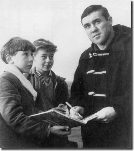 Two starry eyed young fans get Bobby Collins' autograph shortly after he joins Leeds United