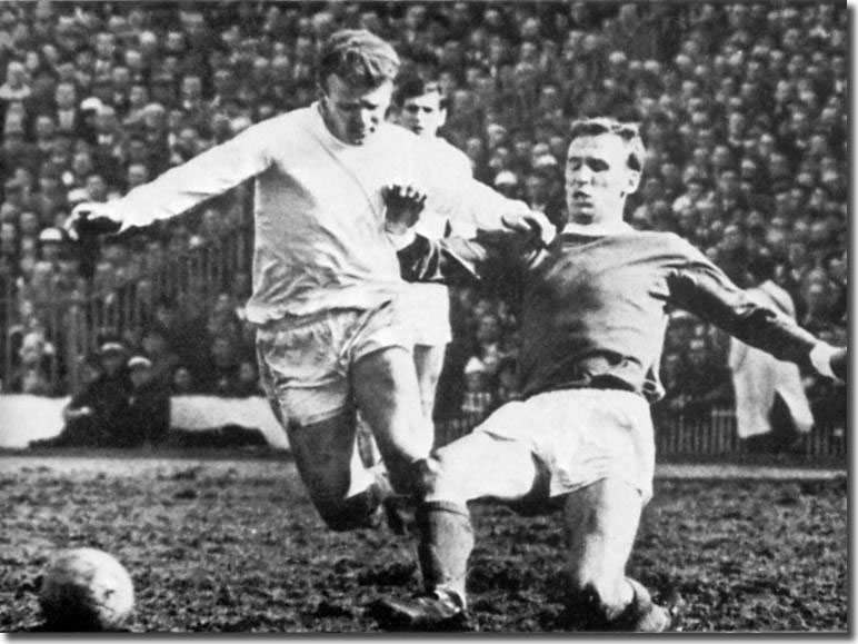 Pat Crerand gets the better of Billy Bremner on this particular occasion