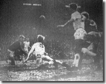 Jack Charlton dives to head clear with Sprake, Reaney and Law all watching