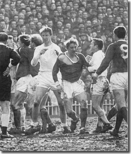 Jack Charlton, Denis Law and Bobby Collins are the main protagonists during this confrontation in the semi final clash with Manchester United