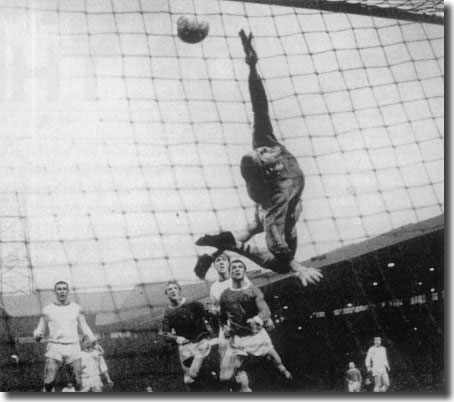 Denis Law scores his first goal in the home game with Arsenal. It was on the same night as Leeds drew 3-3 at Birmingham, and Man U's 3-1 win won them the title