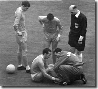Bob Paisley treats Gerry Byrne after his injury in the Cup final - United never managed to exploit the full-back's discomfort