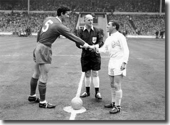 United captain Bobby Collins shakes hands with giant Liverpool skipper Ron Yeats, watched by referee W Clements before the 1965 Cup Final