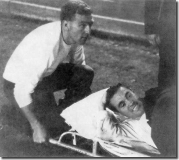 Les Cocker supervises as Bobby Collins is stretchered off in Turin