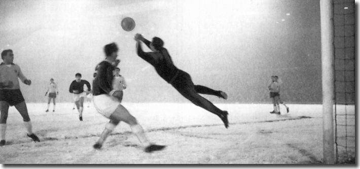 Leipzig keeper Weigang saves Bremner's goalbound effort with Jack Charlton in attendance during the first leg of the second round Fairs Cup tie