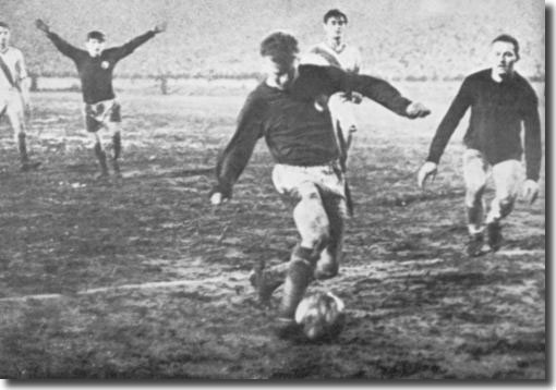 Billy Bremner slots home the fourth goal against Ujpest after rounding the keeper