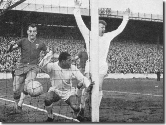 Billy Bremner celebrates as scorer Albert Johanneson ends up in the Zaragoza net in the second leg of the Fairs Cup semi final