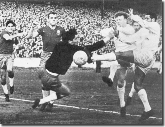 Albert Johanneson scores United's first goal against Real Zaragoza with Billy Bremner in close attendance