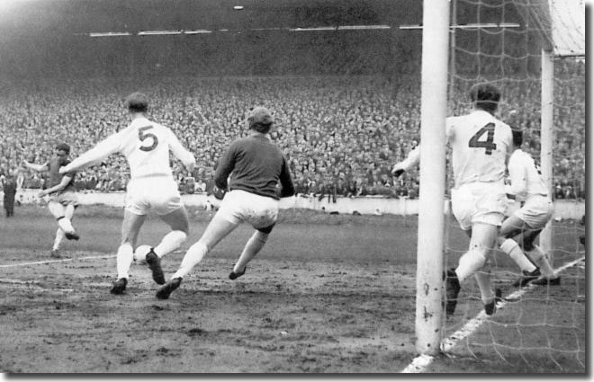 Marcellino opens the scoring for Zaragoza in the semi final play off at Elland Road with Charlton, Sprake, Bremner and Reaney helpless to stop him