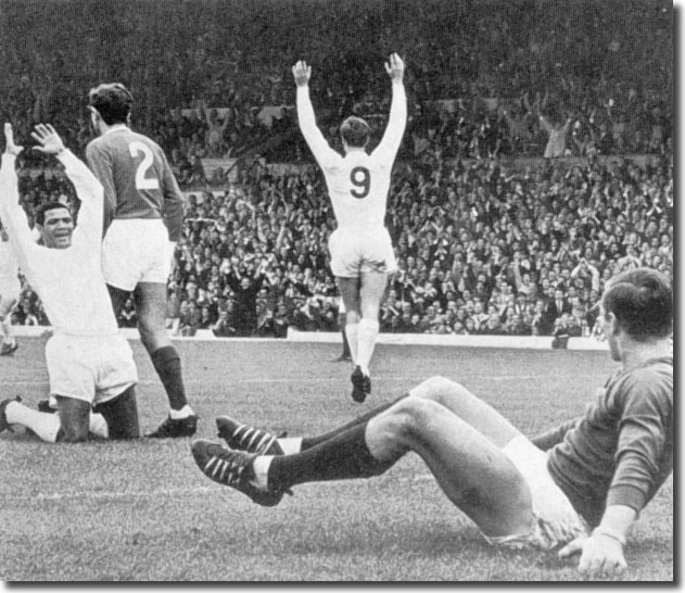 Albert Johanneson acknowledges a bullet header by No 9 Paul Madeley to open the scoring against Manchester United in August