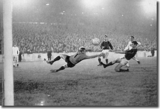 Albert Johanneson slams the ball past DWS keeper Piet Schrijvers to open the scoring at Elland Road - the South African went on to complete a hat trick as United won 5-1
