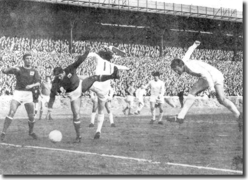 Mick Jones heads home against Forest in the Cup with Gray and Lorimer in attendance