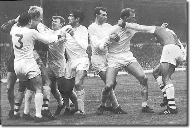 Things turn nasty at Wembley after McLintock's foul on Gary Sprake. Ian Ure is being accosted by Cooper, Bremner and Hunter while Reaney and Charlton tackle McLintock
