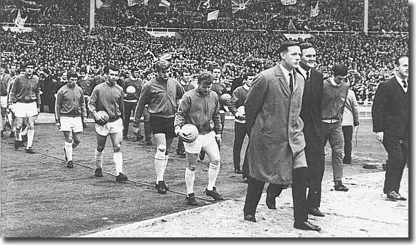 Don Revie and Bertie Mee lead out the two teams - the United players pictured are Gray, Charlton, Cooper, Hunter, Giles, Reaney, Sprake and Bremner
