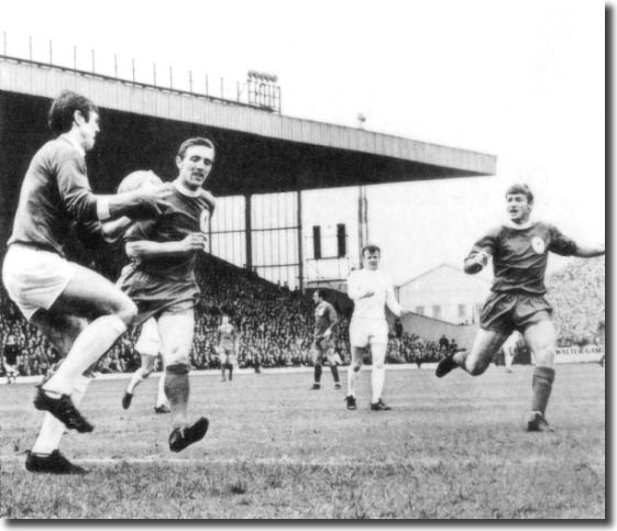 David Harvey collects the ball as Liverpool's Peter Thompson and Roger Hunt move in, while Bremner looks on during the Elland Road clash on May 4