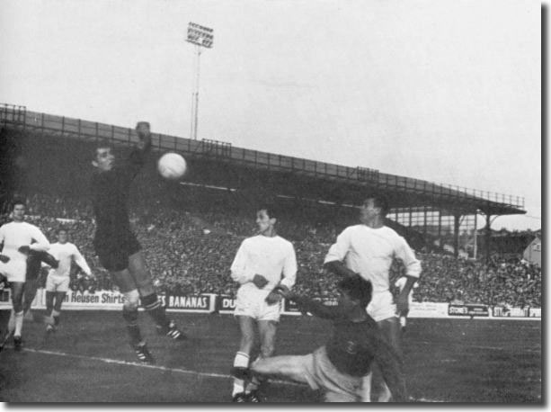 A grounded Jack Charlton puts pressure on the Ferencvaros goal