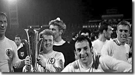 After United's Fairs Cup win in 1968, Mike O'Grady clowns it up for the camera, watched by Charlton, Bremner, Sprake and Jones