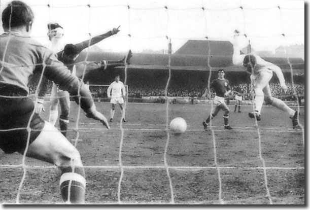Mick Jones gets in a header at Forest goalkeeper Peter Grummitt during the Elland Road clash in February
