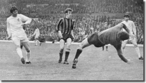 City centre-half Tommy Booth and Peter Lorimer look on as Eddie Gray shoots past Joe Corrigan to give United the lead
