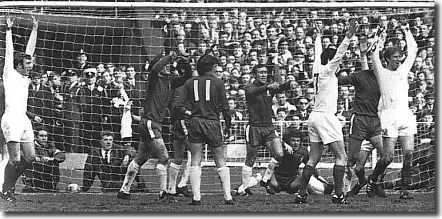 Jones and Lorimer celebrate with Charlton after the centre-half's header opens the scoring at Wembley