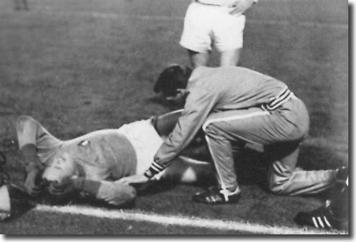 Les Cocker tends to Gary Sprake before the keeper is stretchered off
