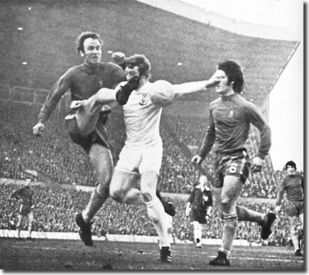 Mick Jones braves the pain of a Dempsey clearance with Webb in close attendance - the clash was typical of a physical encounter