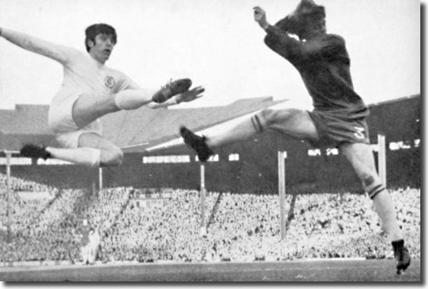 Eddie McCreadie can do nothing to prevent Peter Lorimer getting in a shot in the Cup final replay but it flashed over the bar