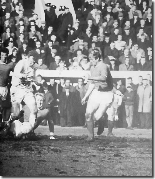 Billy Bremner in action at Old Trafford on the opening day
