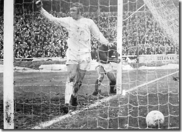 Mick Jones scores one of his three in the Cup trouncing of Swindon
