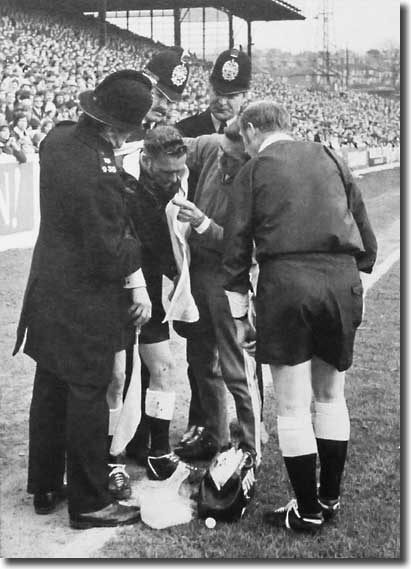 Les Cocker treats a linesman as referee Ray Tinkler and policemen look on during the controversial defeat to West Bromwich Albion