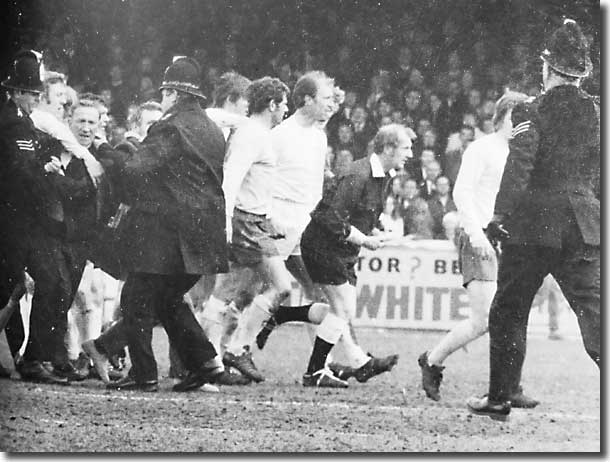 Ray Tinkler breaks into a trot during the pitch invasion against Albion as Jack Charlton looks on in despair